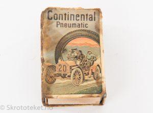 Fyrstikkeskeholder med reklame for Continental dekk og tennisballer